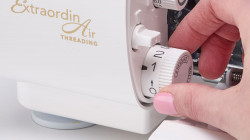 DIAL ADJUSTABLE STITCH LENGTH AND AUTOMATIC ROLLED HEM